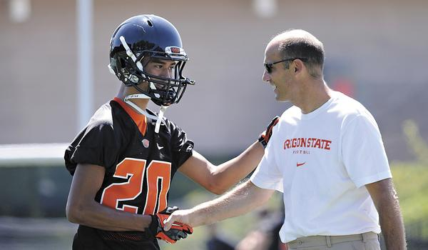 Oregon State coach Mike Riley greets cornerback Chris Hayes during a team practice session Monday. Oregon State is poised to make an impact in the Pac-12 this season.