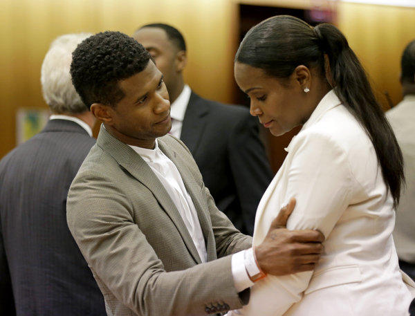 R&B singer Usher hugged his ex-wife Tameka Raymond on Friday in an Atlanta courtroom after a judge dismissed her emergency custody petition.