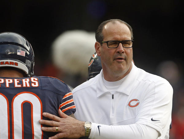 Bears defensive end Julius Peppers and offensive coordinator Mike Tice prepare for the game Dec. 2.