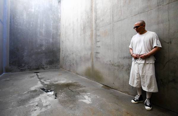 Pelican Bay State Prison inmate Javier Zubiate stands in the concrete recreation area allowing him periods of controlled and highly monitored exercise in the facility's security housing unit.