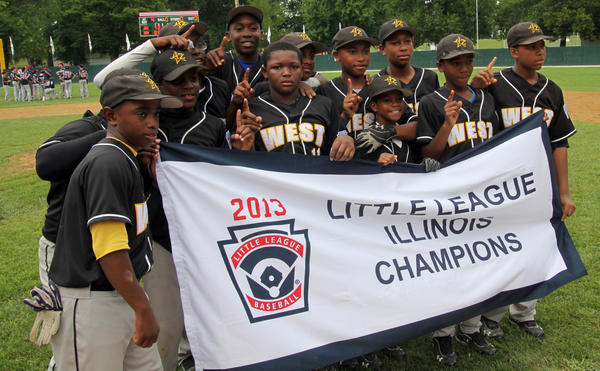 Jackie Robinson West celebrates their state win on July 31 during the Illinois Little League state tournament in Beardstown, Ill.
