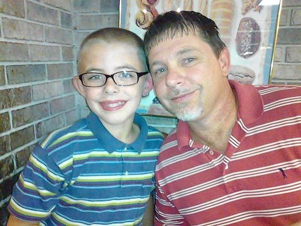 Mike Patterson and his son, Cole. Patterson died 20 days after diving into a creek to save a drowning girl.