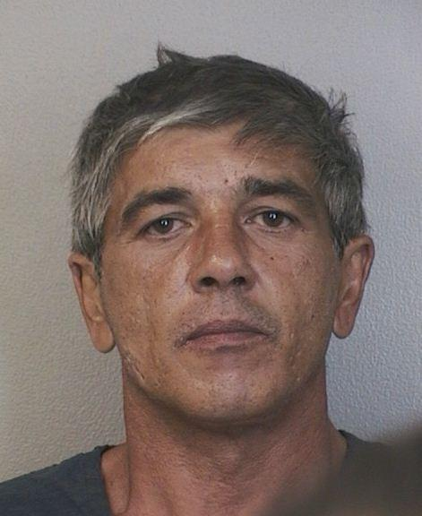 John Quick, 52, was serving 15 years probation for exploitation of the elderly when he was arrested in Davie and accused of exploiting a 91-year-old man