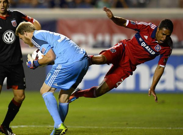 D.C. United goalkeeper Joe Willis makes a save against Fire forward Quincy Amarikwa during the second half at Toyota Park.