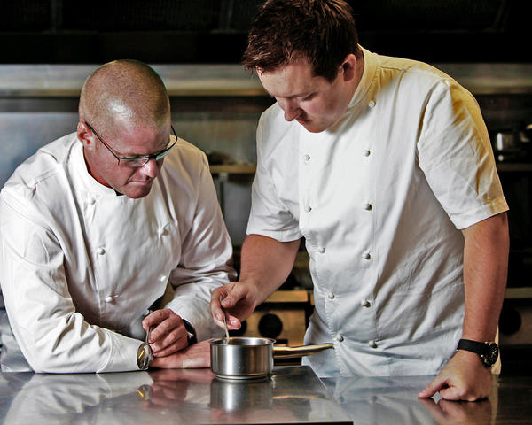 Chefs Heston Blumenthal, left, and Ashley-Palmer Watts work on a sauce.