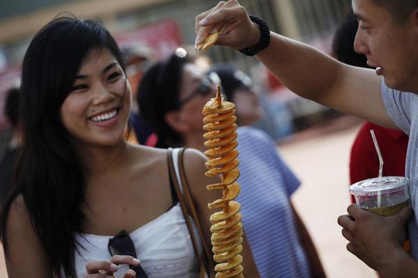 Tiffany Young and Joshua Huang test food at 626 Night Market.