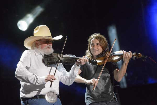 "Charlie Daniels, left, performs in ""CMA Music Festival: Country's Night to Rock"" on ABC."