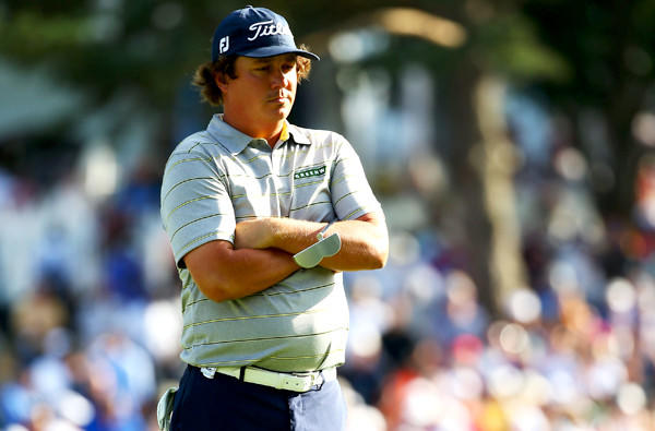 Jason Dufner waits on the 18th green Friday during the second round of the PGA Championship before attempting a birdie putt that could have given him a major record for a round at 62. He two-putted for a 63.