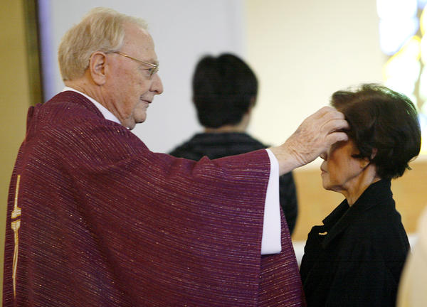 Father Thomas Doyle applies ashes to the forehead of a parishioner at the conclusion on a service on the first day of Lent at the St. James Catholic Church in La Crescenta on Thursday, February 22, 2012. Doyle, who served as a priest for 59 years, much of that time for St. James the Less Catholic Church in La Crescenta, passed away on Aug. 5 at 83 years old.