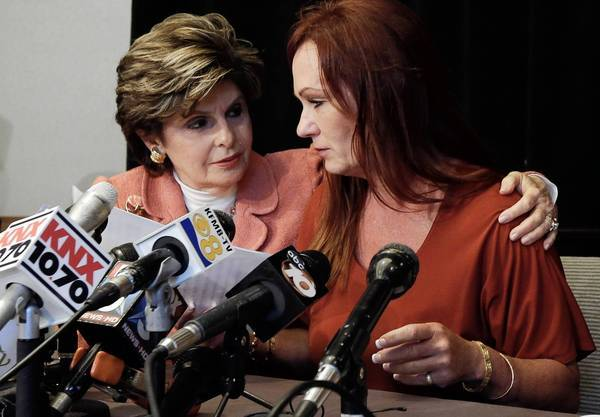Attorney Gloria Allred, left, puts an arm around nurse Michelle Tyler after she alleged during a news conference in San Diego that Mayor Bob Filner had behaved inappropriately with her during a June meeting to ask for help for an injured former Marine.