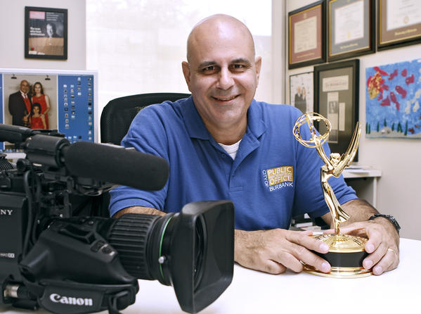 Burbank channel's station manager Peter Mursulian with the Emmy he won recently, at his office in Burbank on Friday, August 9, 2013. Mursulian won the Emmy for a documentary he produced about Burbank's sister city in Botswana.