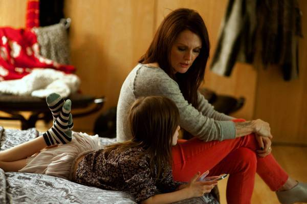 "Julianne Moore, right, and Onata Aprile in ""What Maisie Knew."""