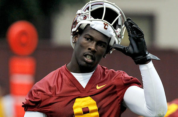 USC receiver Marqise Lee takes off his helmet during a break in spring practice.