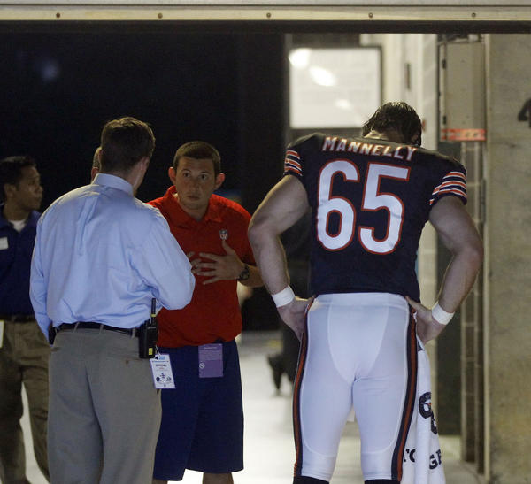 Chicago Bears long snapper Patrick Mannelly (65) walks in the tunnel in the first quarter Friday.