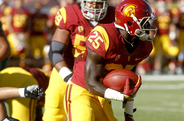 Transfer Silas Redd, who rushed for 905 yards and 10 touchdowns last season despite some injuries, leads a deep and talented corps of running backs for USC this season.