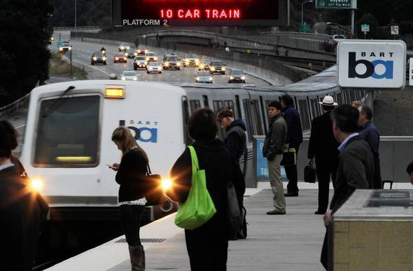 "BART trains and traffic flow at the Rockridge station in Oakland. If the transit system and its biggest unions do not reach a deal by Sunday morning, Gov. Jerry Brown will ask a San Francisco judge to order a 60-day ""cooling-off period"" in which workers would be prevented from walking off the job."