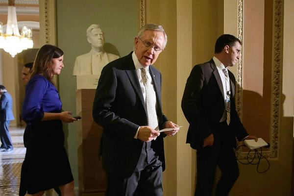 Senate Majority Leader Harry Reid (D-Nev.), center, arrives at a July news conference at which he criticized House Republicans over the sequester.
