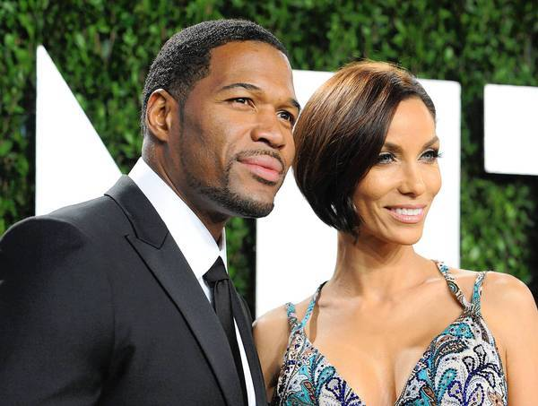 Michael Strahan and Nicole Murphy attend the Vanity Fair Oscar party in February.
