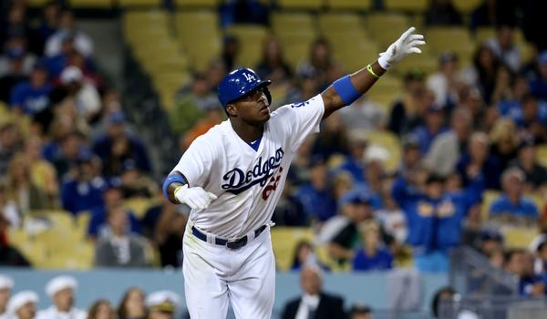 Dodgers right fielder Yasiel Puig hits a run-scoring double in the eighth inning of Friday's 7-6 comeback win over the Tampa Bay Rays.
