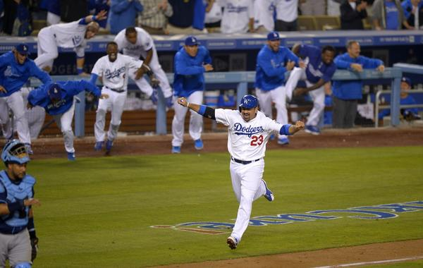 Dodgers first baseman Adrian Gonzalez celebrates as he scores the winning run on a throwing error by Tampa Bay's Fernando Rodney in the ninth inning of the Dodgers' 7-6 comeback victory Friday.