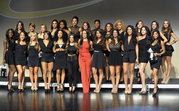 The 2013- 2014 Heat Dance Team pose for their first team photograph after their final audition, Friday, August 9, 2013 at Miami-Dade County Auditorium.
