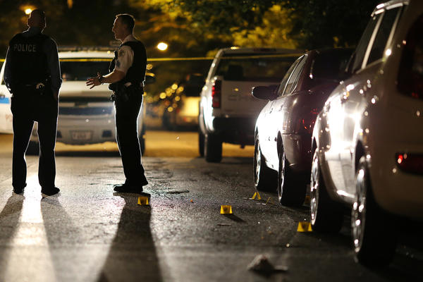 Chicago police at the scene where 26-year-old male was shot in the 1400 block of N. Spaulding Ave. in Chicago on Aug. 1.