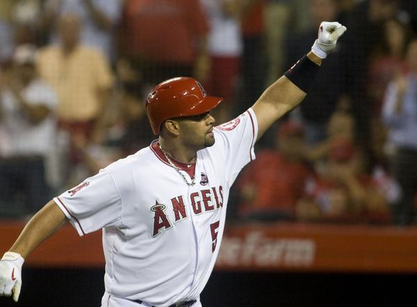 The Los Angeles Angels' Albert Pujols celebrates after a home run this season.