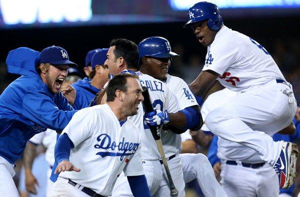 Dodgers first baseman Adrian Gonzalez is mobbed by teammates after scoring the winning run against the Tampa Bay Rays in the ninth inning Friday night at Dodger Stadium.