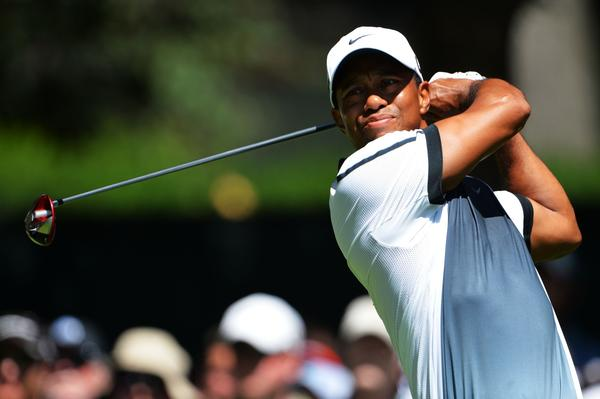 Tiger Woods hits his tee shot on the eighth hole during the third round of the 95th PGA Championship on Saturday.
