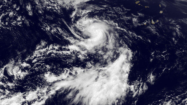 Tropical Storm Dorian on July 24. Federal forecasters are slightly reducing their prediction for a busy Atlantic hurricane season.
