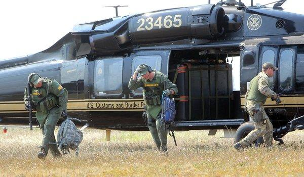 Law enforcement personnel disembark from a Blackhawk helicopter at the Cascade Airport in Idaho after searching for Hannah Anderson and James DiMaggio in the Idaho backcountry Saturday.