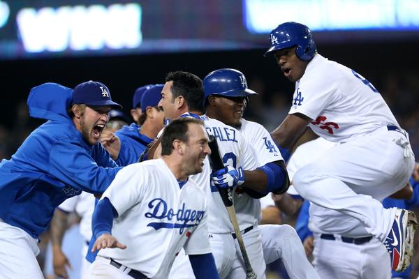 The Dodgers celebrate their ninth-inning victory over the Rays on Friday. (Getty Photo)