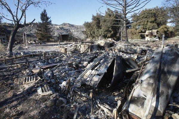 A view of a burned-out home in the Poppet Flats after the Silver fire raced through the neighborhood.