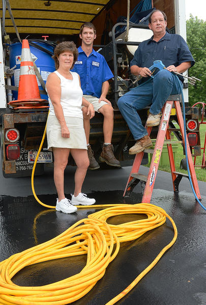 Sandy, Zach and Tim Fields started the business Complete Power Wash after their consruction business went out due to the recession.