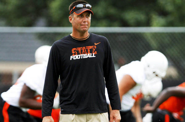 Oklahoma State Coach Mike Gundy and his Cowboys, coming off an 8-5 season, are the Big 12 Conference favorites.