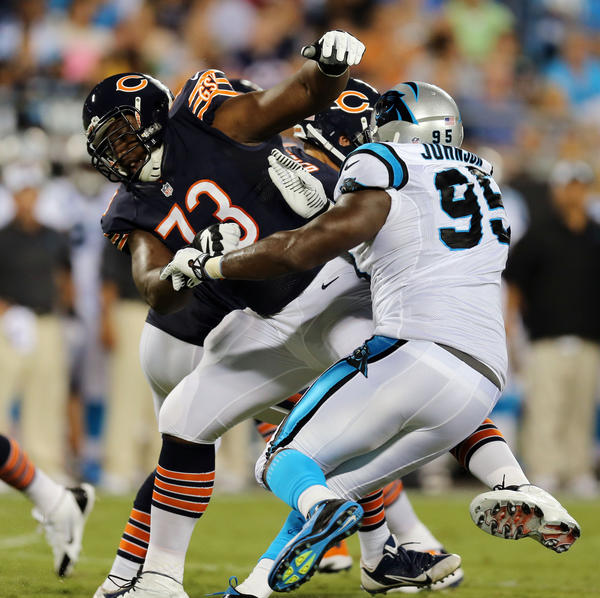 Bears offensive lineman J'Marcus Webb tries to block the Panthers' Charles Johnson on Friday. (Brian Cassella/Tribune Photo)