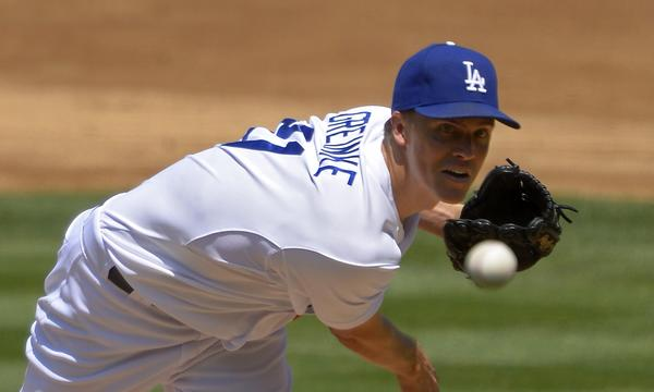 Dodgers starter Zack Greinke delivers a pitch during the Saturday's 5-0 victory over the Tampa Bay Rays.