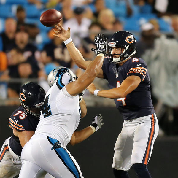 Bears quarterback Matt Blanchard, right, passes over Panthers defensive tackle Sione Fua. (Brian Cassella/Tribune Photo)