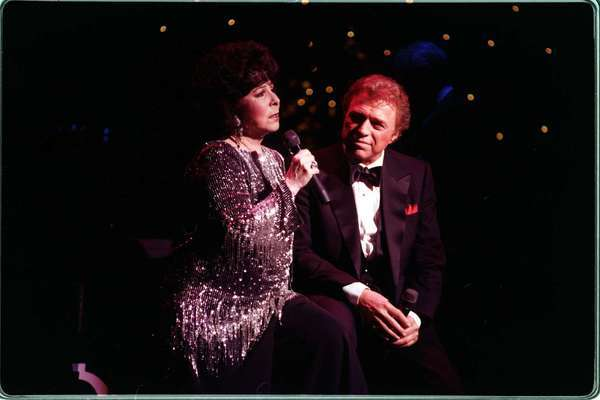 Eydie Gorme performing with her husband, Steve Lawrence, in 1996.