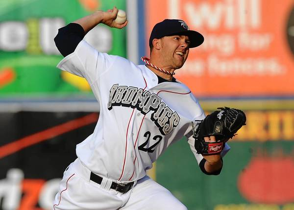 IronPigs' Tyler Cloyd delivers a pitch against the Pawtucket PawSox during their game at Coca-Cola Park in Allentown Tuesday July 9, 2013.