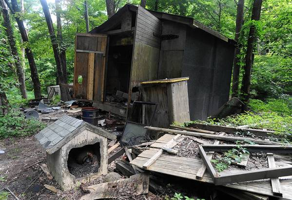 State Police searched Rockne Newell's property along Flyte Road in Ross Township that was involved in a long-running dispute with the township over a dilapidated property.