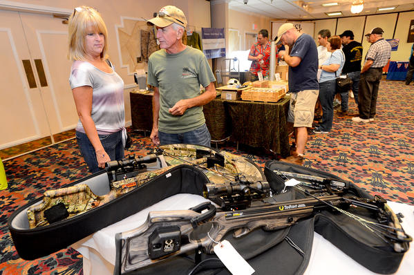 Sherry and Bob Davis of Hagerstown look over a few crossbows from Keystone Country Store Saturday during the Gun & Outdoor Sportsman Expo at Hager Hall in Hagerstown.
