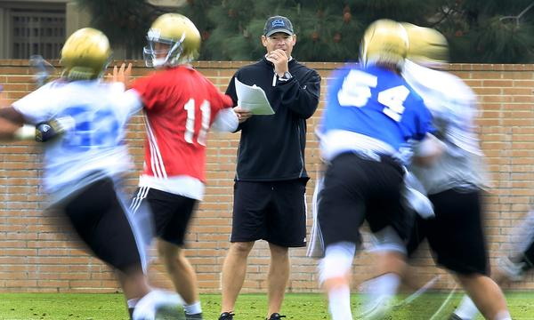UCLA Coach Jim Mora likes to see his players put pressure on one another during team practices.