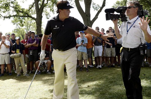 Phil Mickelson asks a cameraman to give him more space while preparing to hit out of the rough at No. 7 during the third round of the PGA Championship on Saturday. Mickelson took a triple bogey on the hole.