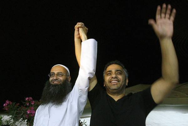 Lebanese singer Fadel Shaker, right, appears at a July 2012 concert with militant sheik Ahmad Assir. Shaker, a onetime superstar, sang Muslim songs.