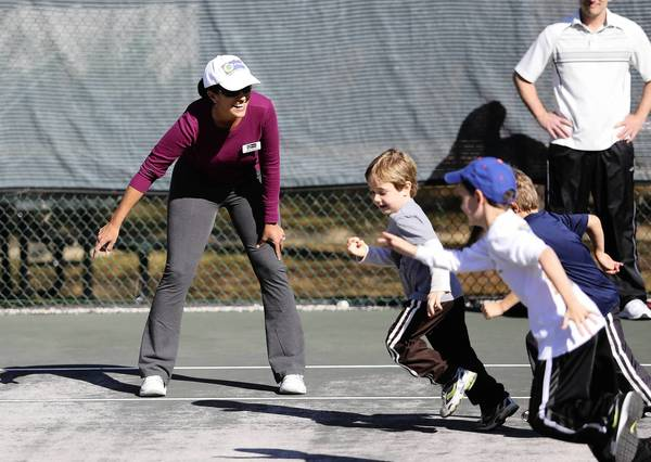 Future tennis players warm up with coach Diana Belton on Monday, March 3,. 2013, in Tavares. Youngsters learned to play tennis at a Tennis Festival, designed to get kids active and excited about tennis, being hosted by Dtennis. DTennis is a professional tennis management and instructional company that serves Central Florida. (Tom Benitez/Orlando Sentinel)