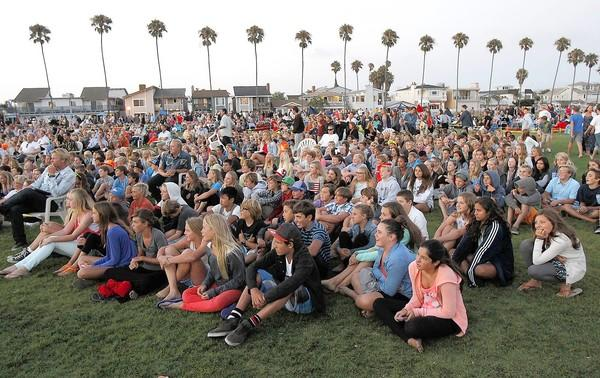 Newport Beach Junior Lifeguard graduates and their instructors watch a video from the season's events during Friday night's event at Balboa Peninsula.