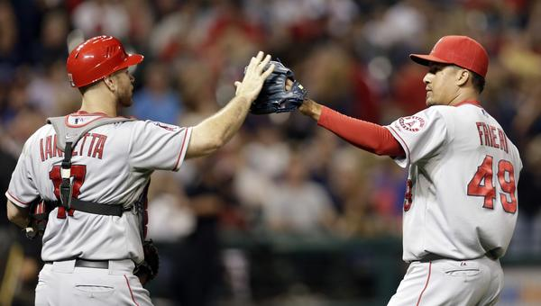 Angels catcher Chris Iannetta, left, and closer Ernesto Frieri celebrate following the Angels' 7-2 win Saturday over the Cleveland Indians.