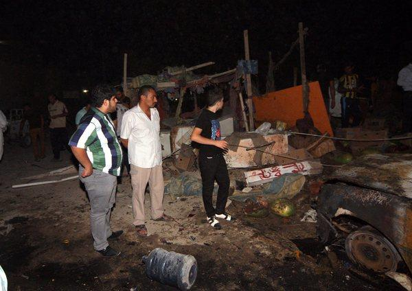 At least 69 killed in wave of bombings in Iraq