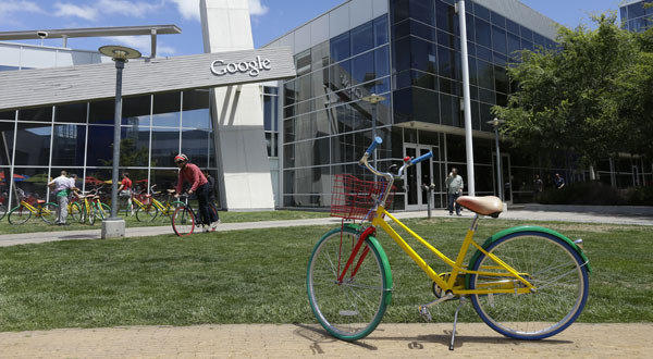 Employees travel around campus via bicycles at Google headquarters in Mountain View, Calif.